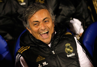 PONFERRADA, SPAIN - DECEMBER 13: Head coach Jose Mourinho of Real Madrid smiles before of the round of last 16 Copa del Rey first leg match between Ponferradina and Real Madrid at Estadio El Toralin on December 13, 2011 in Ponferrada, Spain. (Photo by Ang
