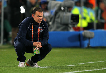 JOHANNESBURG, SOUTH AFRICA - JUNE 28:  Marcelo Bielsa head coach of Chile looks on during the 2010 FIFA World Cup South Africa Round of Sixteen match between Brazil and Chile at Ellis Park Stadium on June 28, 2010 in Johannesburg, South Africa.  (Photo by