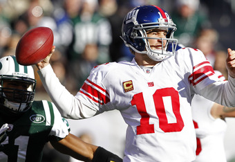 EAST RUTHERFORD, NJ - DECEMBER 24:  Eli Manning #!0 of the New York Giants looks to throw a pass against the New York Jets during the first quarter of a game at MetLife Stadium on December 24, 2011 in East Rutherford. New Jersey. (Photo by Rich Schultz /G