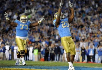 PASADENA, CA - NOVEMBER 06:  Jonathan Franklin #23 of the UCLA Bruins celebrates his touchdown with Darius Savage #77 to tie the Oregon State Beavers 14-14 during the third quarter at the Rose Bowl on November 6, 2010 in Pasadena, California.  (Photo by H