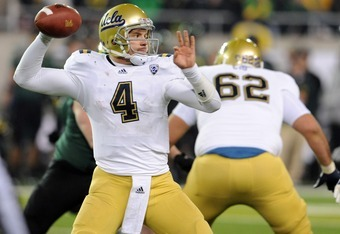 EUGENE, OR - DECEMBER 02 : Quarterback Kevin Prince #4 of the UCLA Bruins throws a pass during the third quarter of the Pac-12 Championship against the UCLA Bruins at Autzen Stadium on December 2, 2011 in Eugene, Oregon. The Ducks won the game 49-31 to ea