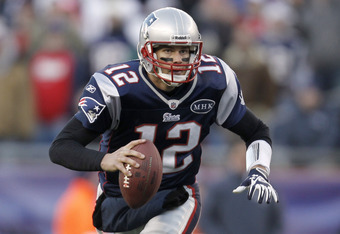FOXBORO, MA - DECEMBER 24: Tom Brady #12 of the New England Patriots scrambles against the Miami Dolphins during the second half of New England's 27-24 win at Gillette Stadium on December 24, 2011 in Foxboro, Massachusetts.  (Photo by Winslow Townson/Gett