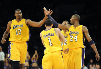 LOS ANGELES, CA - JANUARY 05:  Andrew Bynum #17, Kobe Bryant #24, Jordan Farmar #1 and Shannon Brown #12 of the Los Angeles Lakers celebrate a score on way to an 88-79 win over the Houston Rockets during the second half at Staples Center on January 5, 201