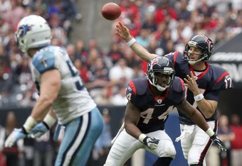 HOUSTON, TX - January 01: Quarterback Jake Delhomme #17 of the Houston Texans completes a pass against the Tennessee Titans on January 1, 2012 at Reliant Stadium in Houston, Texas. (Photo by Thomas B. Shea/Getty Images)