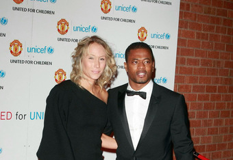 MANCHESTER, UNITED KINGDOM - DECEMBER 12: Sandra Evra and Patrice Evra attend Manchester United 'United for UNICEF' - Gala Dinner at Old Trafford on December 12, 2011 in Manchester, England.  (Photo by Nathan Cox/Getty Images)