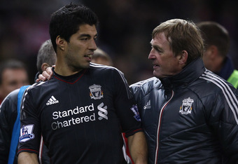 STOKE ON TRENT, ENGLAND - OCTOBER 26:  Liverpool manager Kenny Dalglish congratulates his double goal scorer Luis Suarez at end of the match during the Carling Cup Fourth Round match between Stoke City and Liverpool at Britannia Stadium on October 26, 201