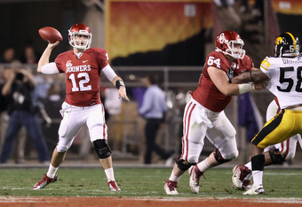 TEMPE, AZ - DECEMBER 30:  Quarterback Landry Jones #12 of the Oklahoma Sooners throws a pass during the Insight Bowl against the Iowa Hawkeyes at Sun Devil Stadium on December 30, 2011 in Tempe, Arizona.  (Photo by Christian Petersen/Getty Images)