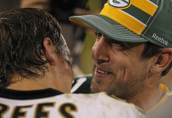 GREEN BAY, WI - SEPTEMBER 08: Aaron Rodgers #12 of the Green Bay Packers talks with Drew Brees #9 of the New Orleans Saints after the NFL opening season game at Lambeau Field on September 8, 2011 in Green Bay, Wisconsin. The Packers defeated the Saints 42