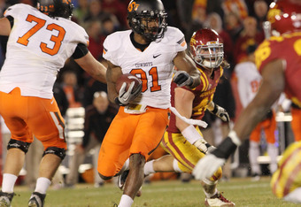 AMES, IA - NOVEMBER 18:  Justin Blackmon #81 of the Oklahoma State Cowboys runs the ball against the Iowa State Cyclones at Jack Trice Stadium November 18, 2011 in Ames, Iowa.  (Photo by Reese Strickland/Getty Images)