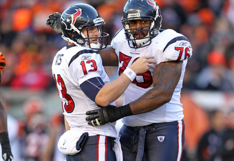 CINCINNATI, OH - DECEMBER 11:  T.J. Yates #13 and Duane Brown#76 of the Houston Texans celebrates after Yates threw a toucdown pass in the Texans 20-19 win over the Cincinnati Bengals during the NFL game at Paul Brown Stadium on December 11, 2011 in Cinci