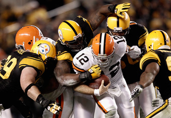 PITTSBURGH, PA - DECEMBER 08:  Colt McCoy #12 of the Cleveland Browns is stopped by the Pittsburgh Steelers defense at Heinz Field on December 8, 2011 in Pittsburgh, Pennsylvania.  (Photo by Jared Wickerham/Getty Images)