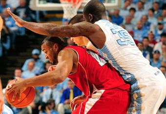 CHAPEL HILL, NC - NOVEMBER 30:  Tyler Zeller #44 and Reggie Bullock #35 of the North Carolina Tar Heels double-team Jordan Taylor #11 of the Wisconsin Badgers during play at the Dean Smith Center on November 30, 2011 in Chapel Hill, North Carolina.  (Phot