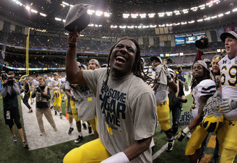 NEW ORLEANS, LA - JANUARY 03:  Denard Robinson #16 of the Michigan Wolverines celebrates after Michigan won 23-20 in overtime against the Virginia Tech Hokies during the Allstate Sugar Bowl at Mercedes-Benz Superdome on January 3, 2012 in New Orleans, Lou