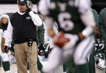 EAST RUTHERFORD, NJ - DECEMBER 24:  Head coach Rex Ryan of the New York Jets looks on as quarterback Mark Sanchez #6 drops back to pass during a game at MetLife Stadium on December 24, 2011 in East Rutherford. New Jersey. The Giants won 29 - 14. (Photo by