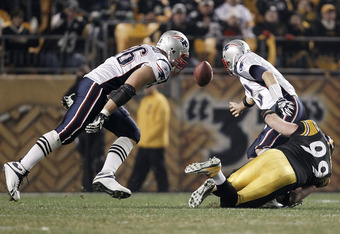 PITTSBURGH, PA - OCTOBER 30:  Brett Keisel #99 of the Pittsburgh Steelers tackles and strips the ball from Tom Brady #12 of the New England Patriots during their last drive of the game during the game on October 30, 2011 at Heinz Field in Pittsburgh, Penn