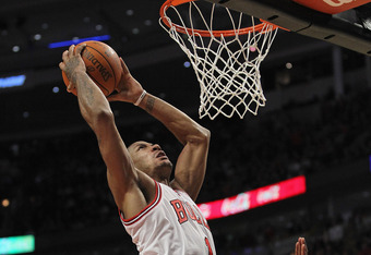 CHICAGO, IL - JANUARY 03: Derrick Rose #1 of the Chicago Bulls shoots over Josh Smith #5 of the Atlanta Hawks at the United Center on January 3, 2012 in Chicago, Illinois. The Bulls defeated the Hawks 76-74. NOTE TO USER: User expressly acknowledges and a