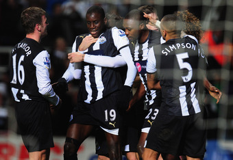 NEWCASTLE UPON TYNE, ENGLAND - JANUARY 04:  Newcastle forward Demba Ba (c) celebrates with team mates after scoring during the Barclays Premier league game between Newcastle United and Manchester United at St James' Park on January 4, 2012 in Newcastle up