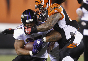 CINCINNATI, OH - JANUARY 01:  Rey Maualuga #58 of the Cincinnati Bengals tackles Ray Rice #27 of the Baltimore Ravens during their game at Paul Brown Stadium on January 1, 2012 in Cincinnati, Ohio. The Ravens defeated the Bengals 24-16.  (Photo by John Gr