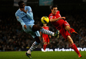 Stewart Downing gets an early effort in against City's Koly Touré