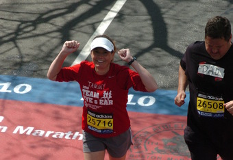 Tammy Stapleton crossing the finish line during the 114th running of the Boston Marathon in 2010