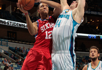 NEW ORLEANS, LA - JANUARY 04:  Evan Turner #12 of the Philadelphia 76ers shoots the ball over Jason Smith #14 of the New Orleans Hornets at New Orleans Arena on January 4, 2012 in New Orleans, Louisiana.   The 76ers defeated the Hornets 101-93.  NOTE TO U