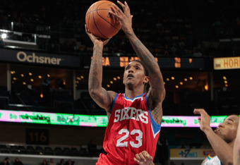 NEW ORLEANS, LA - JANUARY 04:  Lou Williams #23 of the Philadelphia 76ers shoots the ball over Jarrett Jack #2 of the New Orleans Hornets at New Orleans Arena on January 4, 2012 in New Orleans, Louisiana.  The 76ers defeated the Hornets 101-93.   NOTE TO