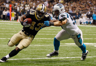 NEW ORLEANS, LA - JANUARY 01:  Darren Sproles #43 of the New Orleans Saints tries to avoid a tackle by Jordan Senn #57 of the Carolina Panthers at the Mercedes-Benz Superdome on January 1, 2012 in New Orleans, Louisiana.  (Photo by Chris Graythen/Getty Im