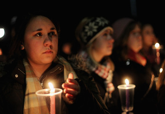 STATE COLLEGE, PA - NOVEMBER 11:  Penn State students and supporters gather for a large candlelight vigil for victims of child abuse in front of Old Main in the wake of the Jerry Sandusky scandal on November 11, 2011 in State College, Pennsylvania. Head f