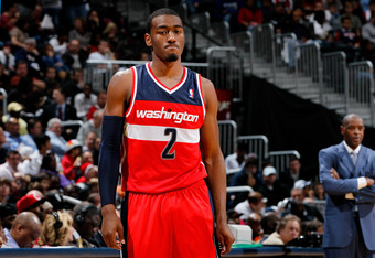 ATLANTA, GA - DECEMBER 28:  John Wall #2 of the Washington Wizards reacts after a turnover against the Atlanta Hawks at Philips Arena on December 28, 2011 in Atlanta, Georgia.  NOTE TO USER: User expressly acknowledges and agrees that, by downloading and