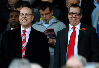 MANCHESTER, ENGLAND - OCTOBER 23:  Avram Glazer and Bryan Glazer (R) look on prior to the Barclays Premier League match between Manchester United and Manchester City at Old Trafford on October 23, 2011 in Manchester, England. (Photo by Laurence Griffiths/