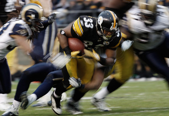 PITTSBURGH, PA - DECEMBER 24:  Isaac Redman #33 of the Pittsburgh Steelers runs with the ball in the second half against the St. Louis Rams during the Christmas Eve game on December 24, 2011 at Heinz Field in Pittsburgh, Pennsylvania.  (Photo by Jared Wic