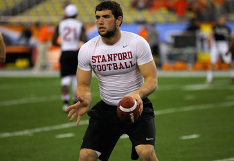 GLENDALE, AZ - JANUARY 02:  Andrew Luck #12 of the Stanford Cardinal warms up against the Oklahoma State Cowboys during the Tostitos Fiesta Bowl on January 2, 2012 at University of Phoenix Stadium in Glendale, Arizona.  (Photo by Doug Pensinger/Getty Imag