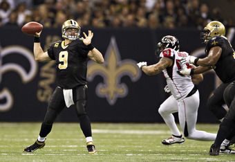 NEW ORLEANS, LA - DECEMBER 26:   Quarterback Drew Brees #9 of the New Orleans Saints throws a pass against the Atlanta Falcons at Mercedes-Benz Superdome on December 26, 2011 in New Orleans, Louisiana.  (Photo by Wesley Hitt/Getty Images)