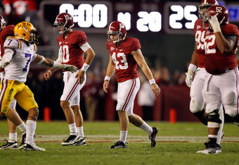 TUSCALOOSA, AL - NOVEMBER 05:  Cade Foster #43 of the Alabama Crimson Tide walks off the field dejected after missing a field goal during overtime against the LSU Tigers at Bryant-Denny Stadium on November 5, 2011 in Tuscaloosa, Alabama.  (Photo by Street