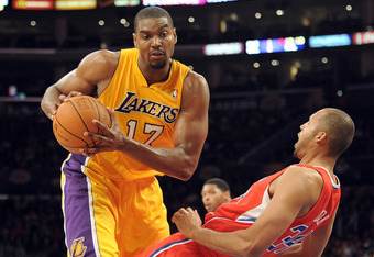 LOS ANGELES, CA - DECEMBER 19:  Andrew Bynum #17 of the Los Angeles Lakers turns as Brian Cook #34 of the Los Angeles Clippers falls during the game at Staples Center on December 19, 2011 in Los Angeles, California. NOTE TO USER: User expressly acknowledg