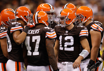 NEW ORLEANS - OCTOBER 24:  Colt McCoy #12 of the Cleveland Browns stands in the huddle during the game against the New Orleans Saints at the Louisiana Superdome on October 24, 2010 in New Orleans, Louisiana.  The Browns defeated the Saints 30-17.  (Photo