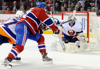 MONTREAL, CANADA - DECEMBER 13:  Al Montoya #35 of the New York Islanders gets down to stop the puck on a shot by Lars Eller #81 of the Montreal Canadiens during the NHL game at the Bell Centre on December 13, 2011 in Montreal, Quebec, Canada.  (Photo by