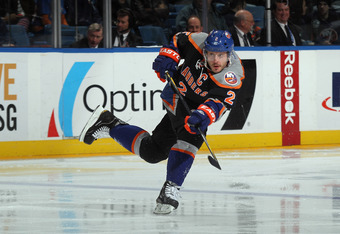 UNIONDALE, NY - DECEMBER 23: Mark Streit #2 of the New York Islanders skates against the Toronto Maple Leafs at the Nassau Veterans Memorial Coliseum on December 23, 2011 in Uniondale, New York.  (Photo by Bruce Bennett/Getty Images)