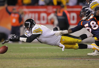 DENVER, CO - JANUARY 08:  Ben Roethlisberger #7 of the Pittsburgh Steelers dives for the ball after losing it against Von Miller #58 of the Denver Broncos during the AFC Wild Card Playoff game at Sports Authority Field at Mile High on January 8, 2012 in D