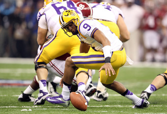 NEW ORLEANS, LA - JANUARY 09:  Jordan Jefferson #9 of the Louisiana State University Tigers loses the ball in the first quarter against the Alabama Crimson Tide during the 2012 Allstate BCS National Championship Game at Mercedes-Benz Superdome on January
