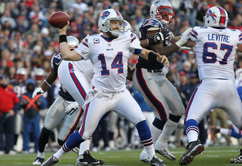 FOXBORO, MA - JANUARY 1:   Ryan Fitzpatrick #14 of the Buffalo Bills throws against the New England Patriots in the first half at Gillette Stadium on January 1, 2012 in Foxboro, Massachusetts. (Photo by Jim Rogash/Getty Images)
