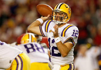 TUSCALOOSA, AL - NOVEMBER 05:  Jarrett Lee #12 of the LSU Tigers drops back to pass against the Alabama Crimson Tide during the first quarter of the game at Bryant-Denny Stadium on November 5, 2011 in Tuscaloosa, Alabama.  (Photo by Streeter Lecka/Getty I