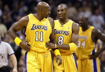 Karl Malone, left, has the highest scoring average in a 16th season but could be soon passed by Kobe Bryant.
