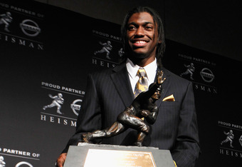 NEW YORK, NY - DECEMBER 10:  Robert Griffin III of the Baylor Bears poses with the trophy after being named the 77th Heisman Memorial Trophy Award winner during a press conference at The New York Marriott Marquis on December 10, 2011 in New York City.  (P