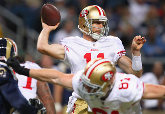 ST. LOUIS, MO - JANUARY 1: Alex Smith #11 of the San Francisco 49ers passes against the St. Louis Rams at the Edward Jones Dome on January 1, 2012 in St. Louis, Missouri.  The 49ers beat the Rams 34-27.  (Photo by Dilip Vishwanat/Getty Images)