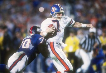 25 Jan 1987:  Quarterback John Elway #7 of the Denver Broncos is being rushed by defensive lineman Leonard Marshall #70 of the New York Giants at Super Bowl  XXI at the Rose Bowl in Pasadena, California.  The Giants won the game, 39-20   Mandatory Credit:
