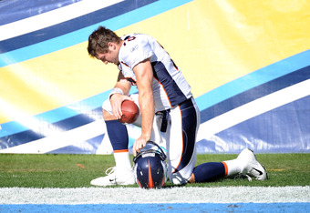 SAN DIEGO, CA - NOVEMBER 27:  Tim Tebow #15 of the Denver Broncos prays before the game against the San Diego Chargers at Qualcomm Stadium on November 27, 2011 in San Diego, California.  The Broncos went on to win 16-13 in overtime.  (Photo by Harry How/G