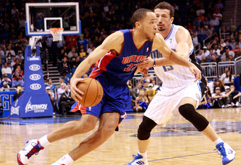 ORLANDO, FL - JANUARY 24:  Tayshaun Prince #22 of the Detroit Pistons drives against Hedo Turkoglu #15 of the Orlando Magic during the game at Amway Arena on January 24, 2011 in Orlando, Florida.  NOTE TO USER: User expressly acknowledges and agrees that,