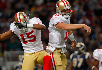 ST. LOUIS, MO - JANUARY 1:  Wide receiver Michael Crabtree #15 and quarterback Alex Smith #11 of the San Francisco 49ers celebrate Crabtree's touchdown in the first half of the game on January 1, 2012 at the Edward Jones Dome in St. Louis, Missouri. The 4