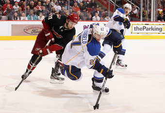 GLENDALE, AZ - DECEMBER 23:  Alex Pietrangelo #27 of the St. Louis Blues attempts to control the puck under pressure from Martin Hanzal #11 of the Phoenix Coyotes during the NHL game at Jobing.com Arena on December 23, 2011 in Glendale, Arizona.  (Photo b